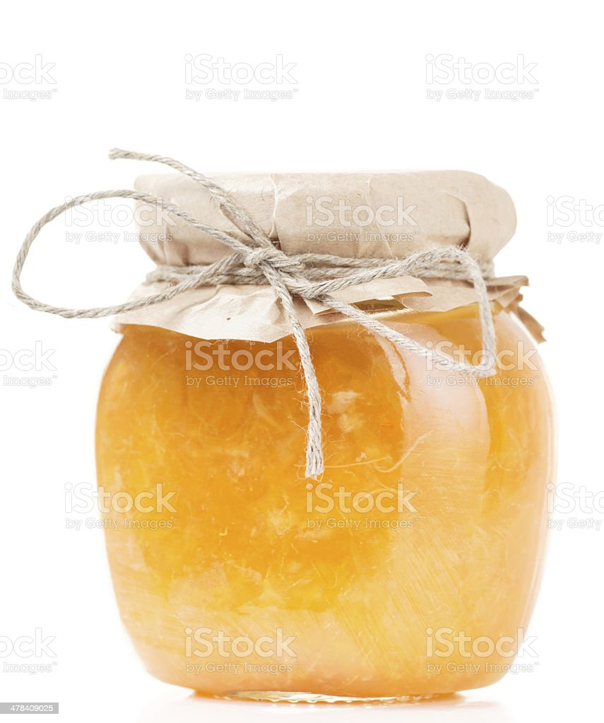 Orange jelly in glass jar isolated on white stock photo