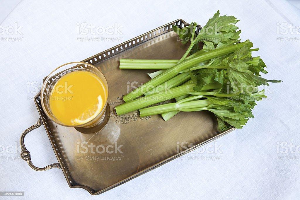 Orange juice and celery stock photo