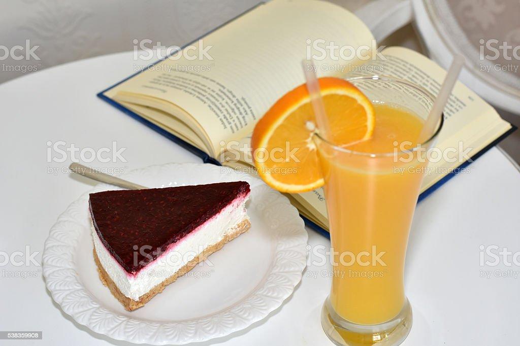 Orange juice and cheesecake stock photo