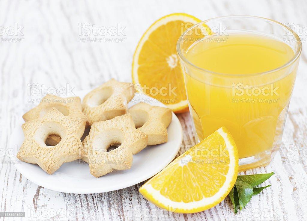 Orange juice and cookies royalty-free stock photo