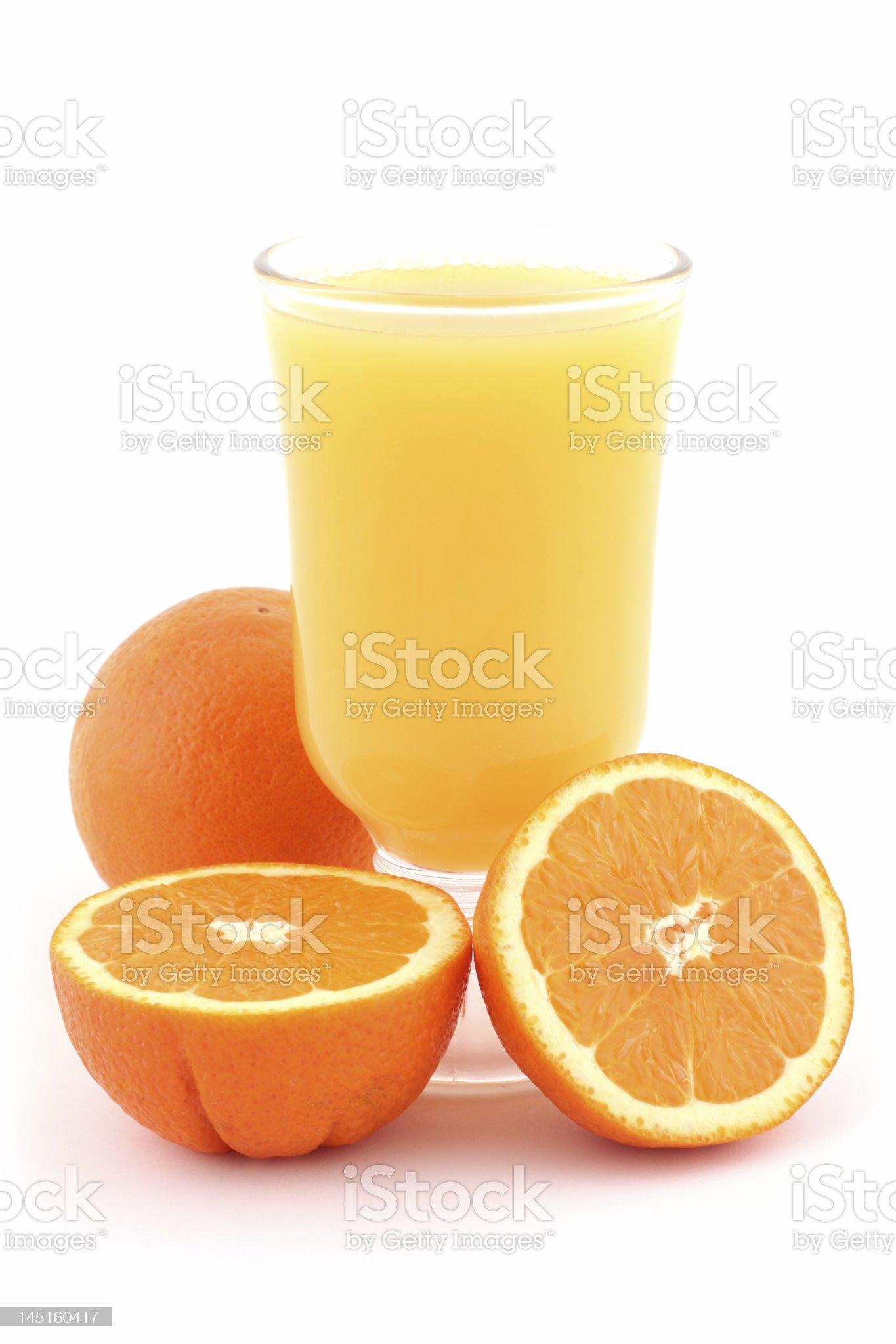 Orange juice and ripe oranges royalty-free stock photo