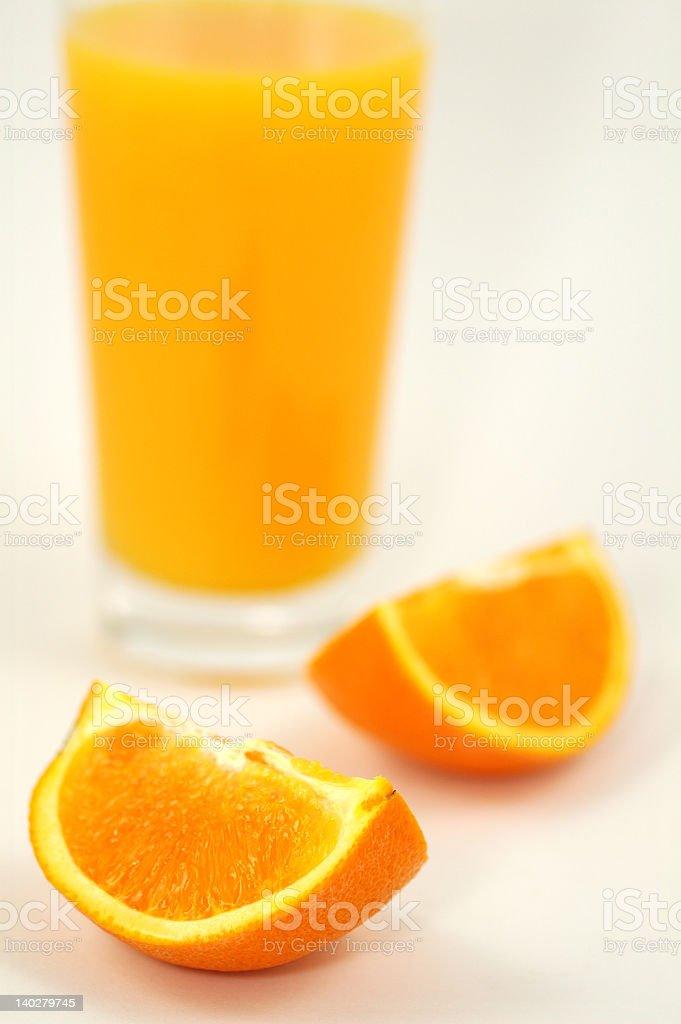 Orange juice and wedges royalty-free stock photo