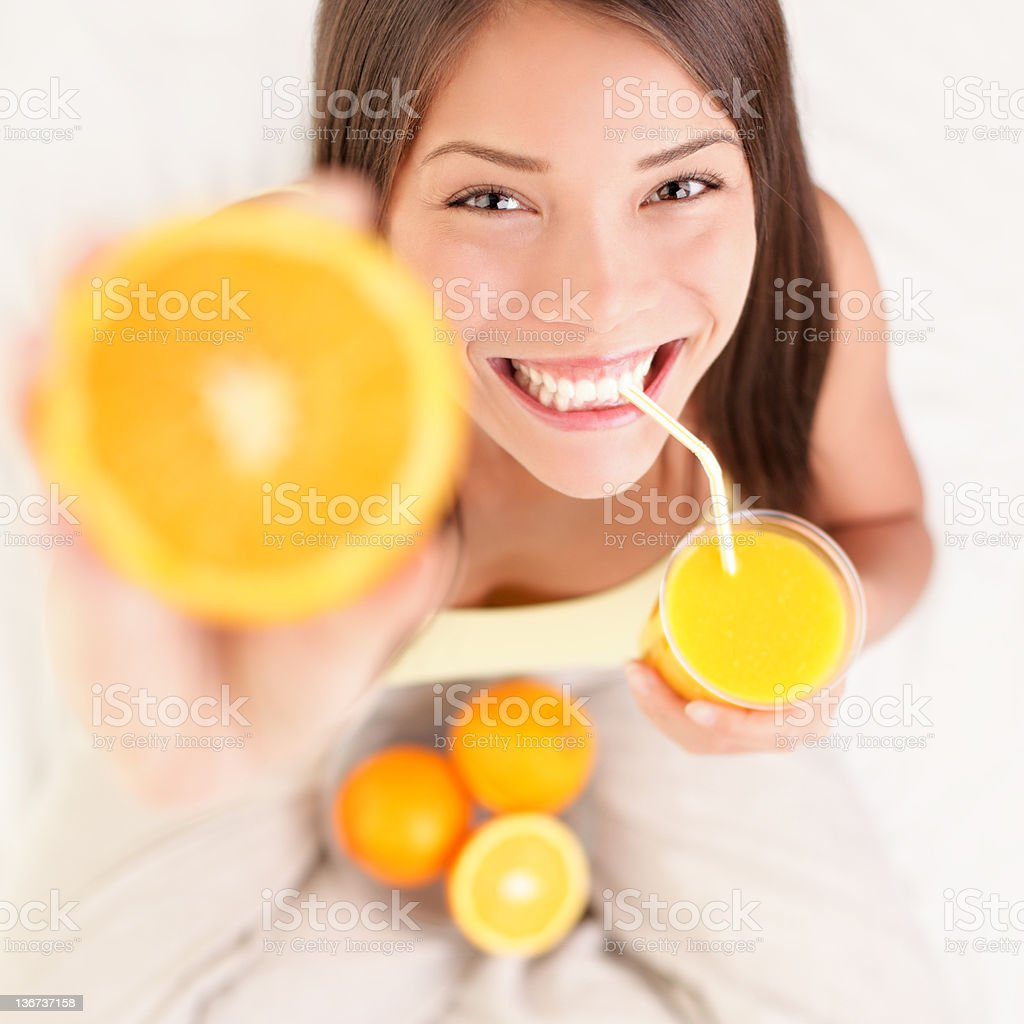 Orange juice drinking woman stock photo