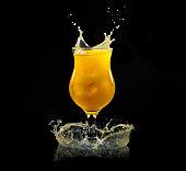 Orange juice in a glass with splash
