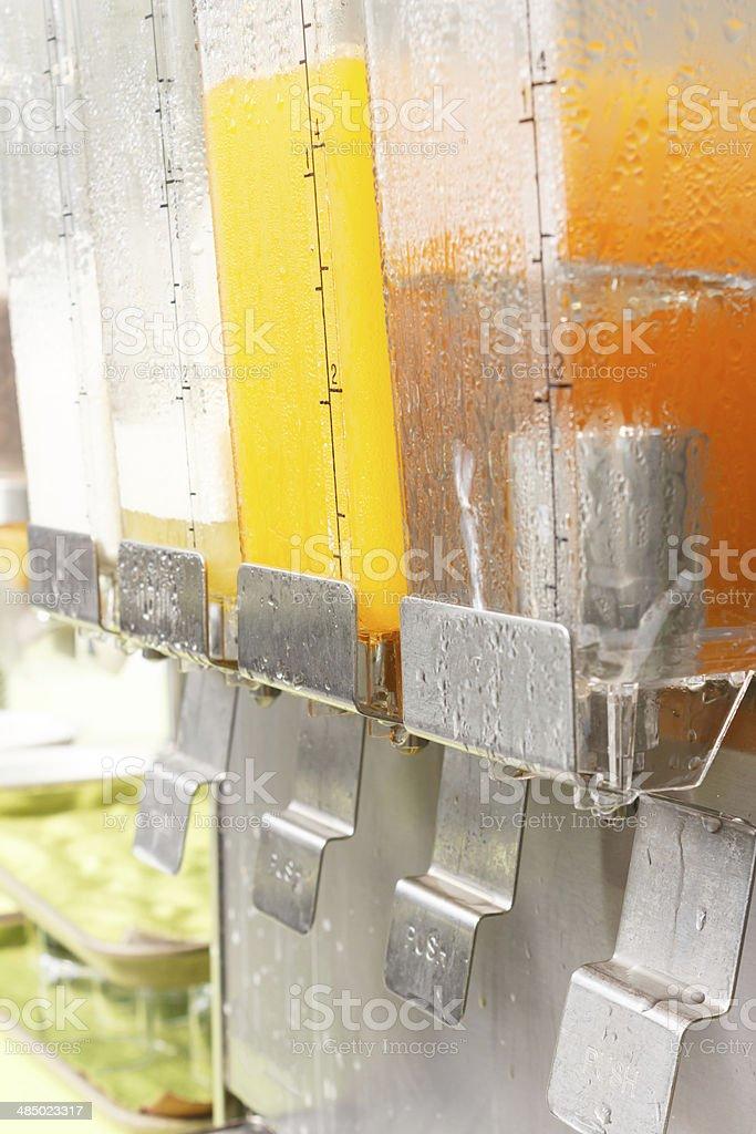 Orange juice in dispenser stock photo
