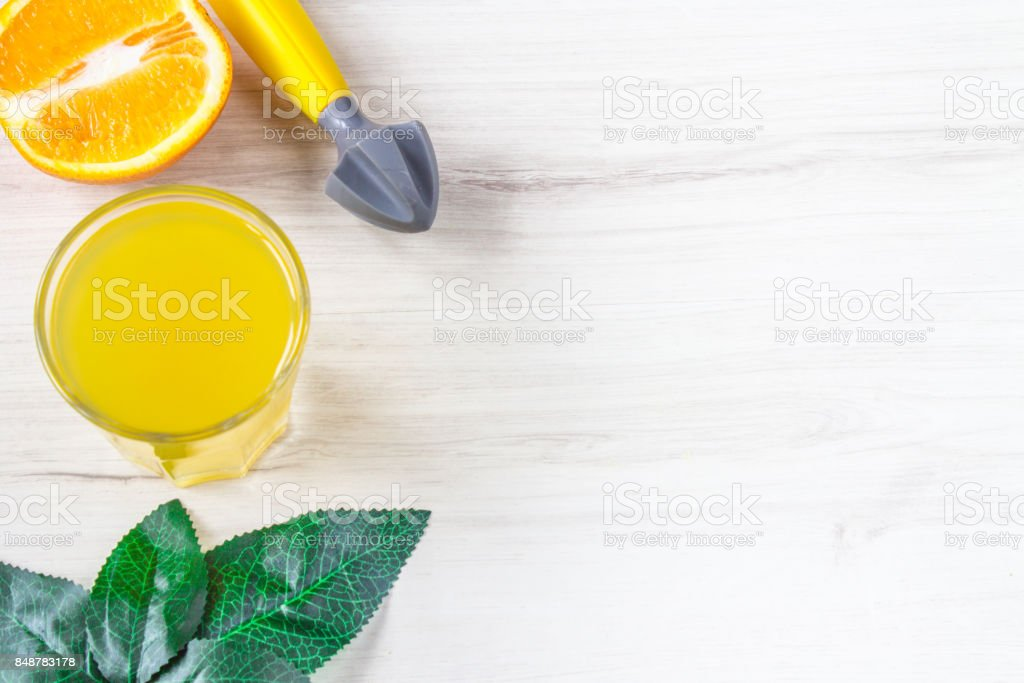 Orange juice in glass, fresh fruits on wooden background stock photo