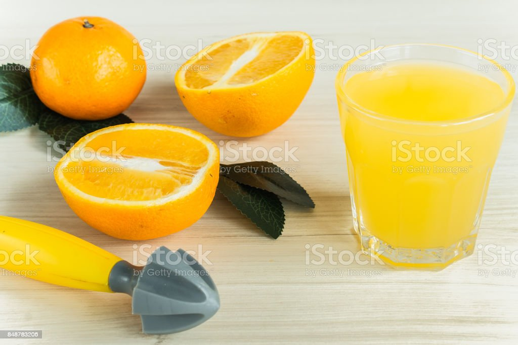 Orange juice in glass, fresh fruits on wooden background stock photo