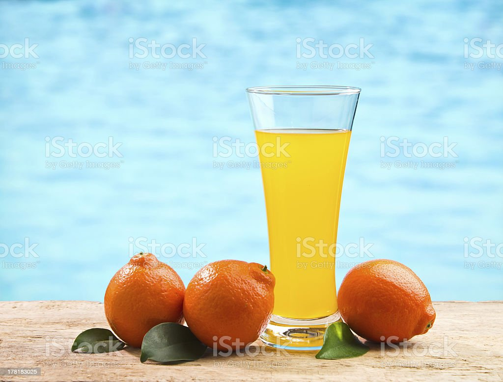 orange juice in glass on a table royalty-free stock photo