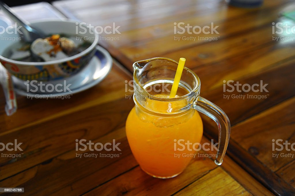orange juice in glass on wooden background (Style Still Life) stock photo