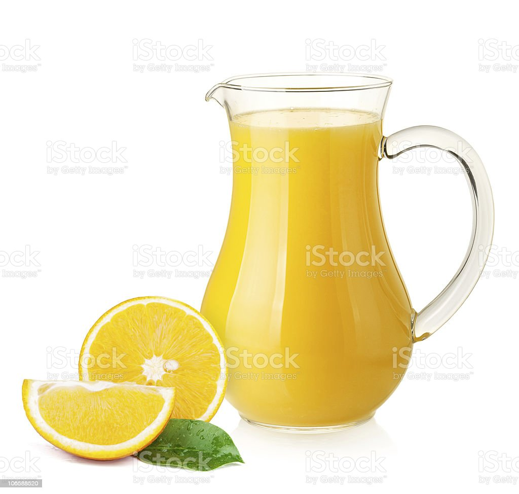 Orange juice in pitcher and oranges royalty-free stock photo