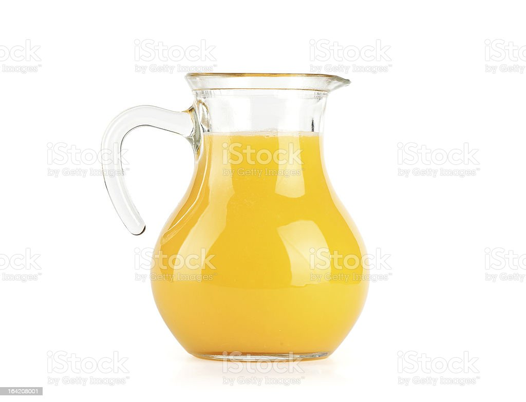 Orange juice in pitcher. Isolated on white background stock photo