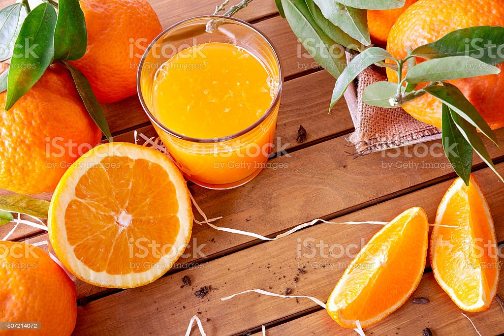Orange juice on a wooden table top stock photo