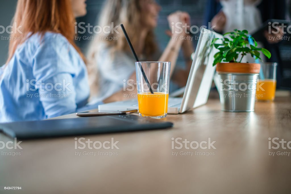 Orange juice on the table in the office stock photo