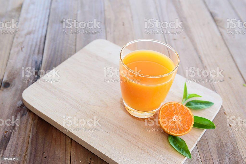 Orange juice on wooden background stock photo