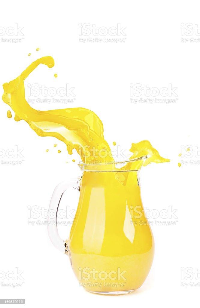 orange juice splash isolated on white royalty-free stock photo
