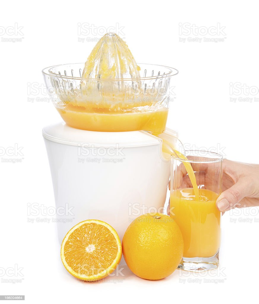 orange juice squeezed with juicer into glass royalty-free stock photo