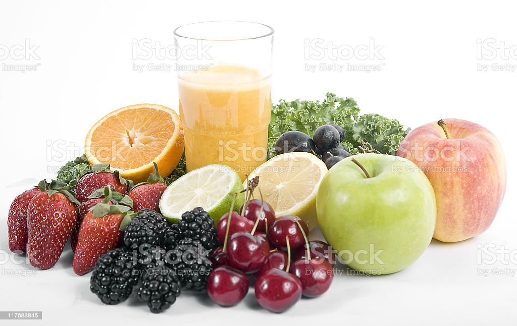 Orange juice with fruit and greens stock photo