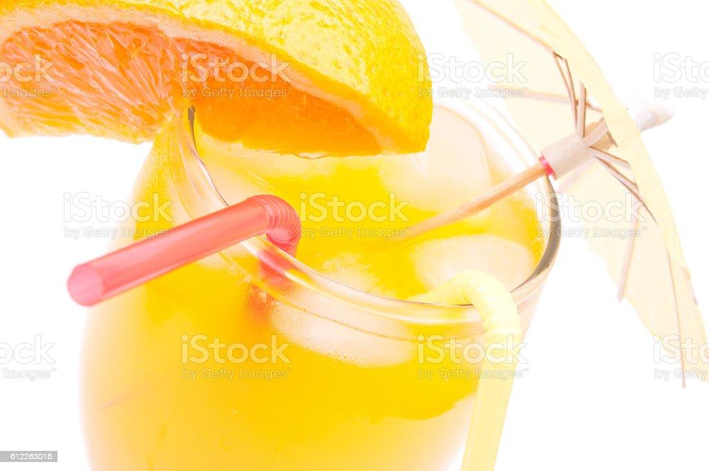 Orange juice with umbrella stock photo