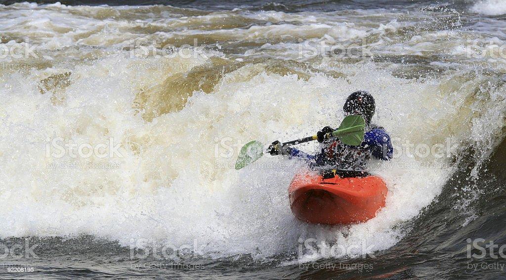 Orange Kayak in Wave royalty-free stock photo