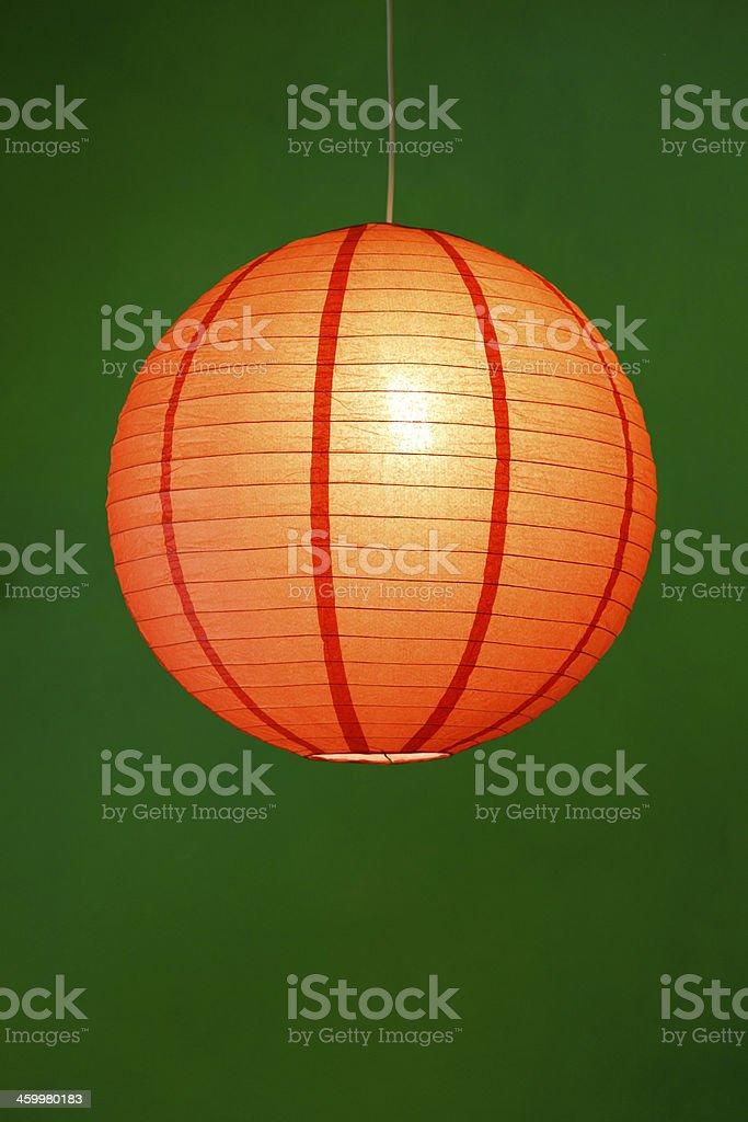 Orange lamp ornament on green background stock photo