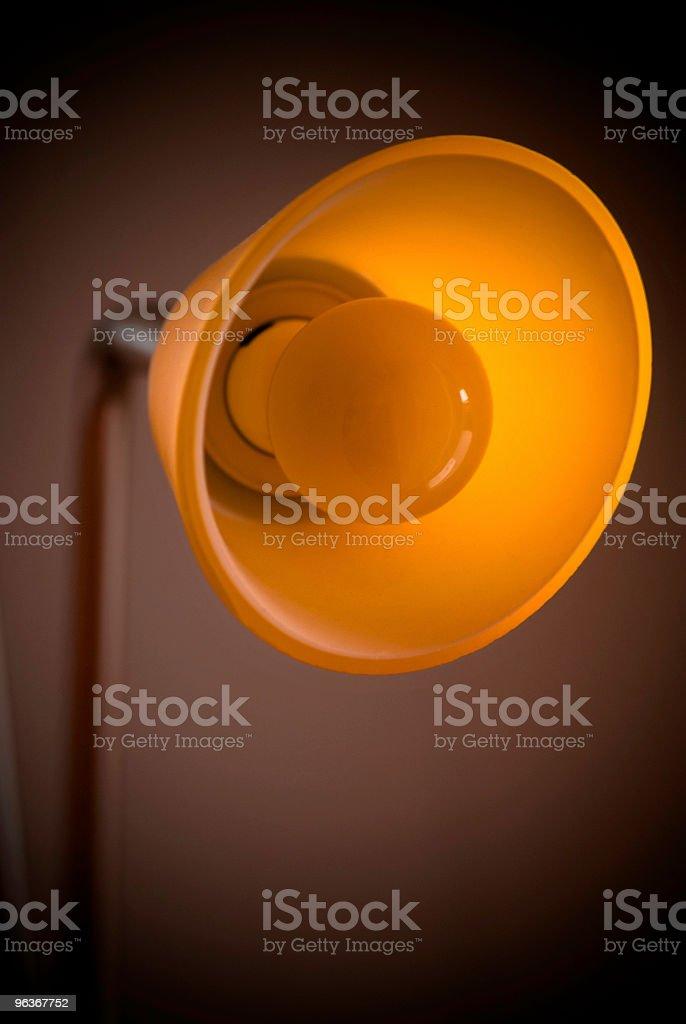 Orange lamp with dark dreamy background in low light stock photo