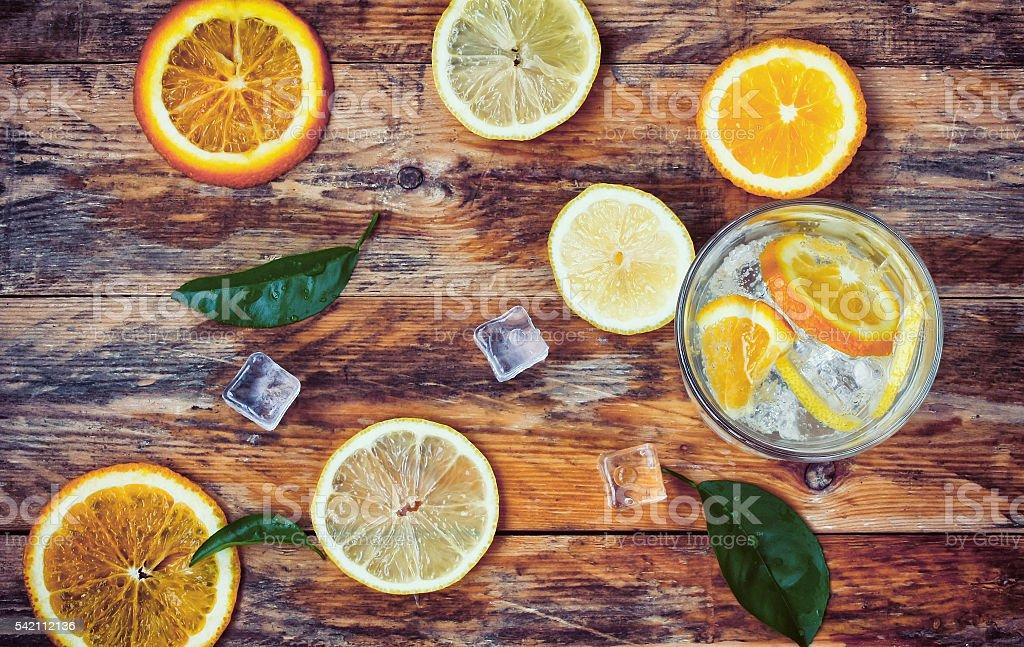 orange, lemon, leaves, glass homemade lemonade, ice stock photo