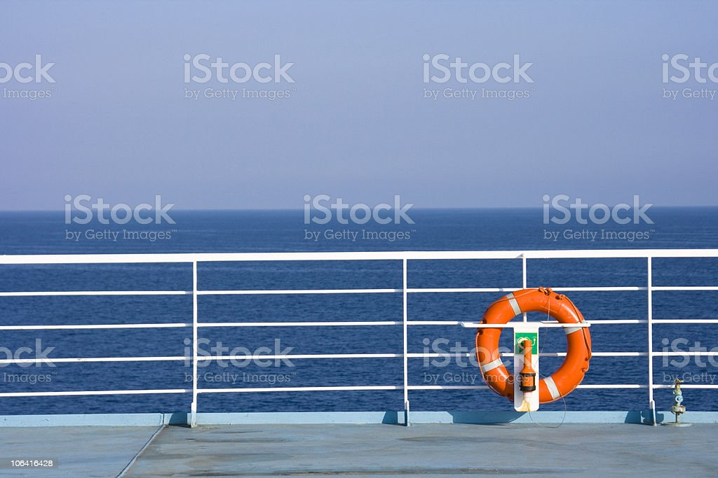 Orange life buoy on the side of a ship stock photo