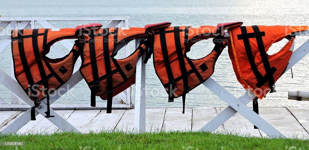 Orange Life Jackets In a Row stock photo