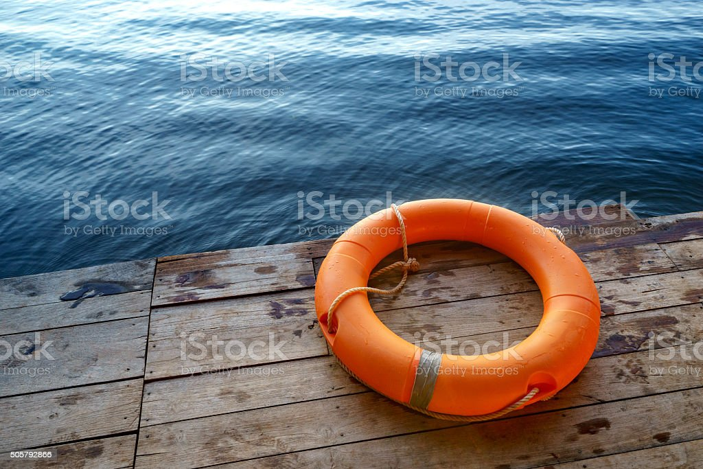 Orange lifebuoy,All Water rescue emergency equipment. stock photo
