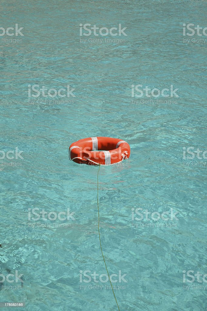 Orange lifesaver on emerald sea stock photo