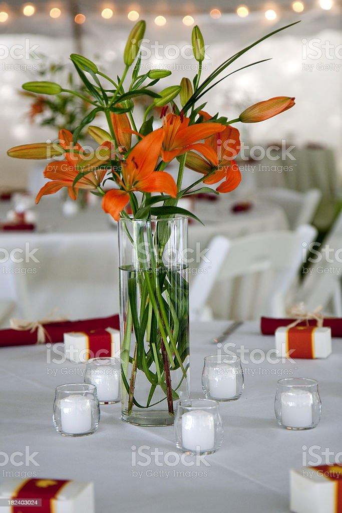 Orange Lily Wedding Centerpiece stock photo