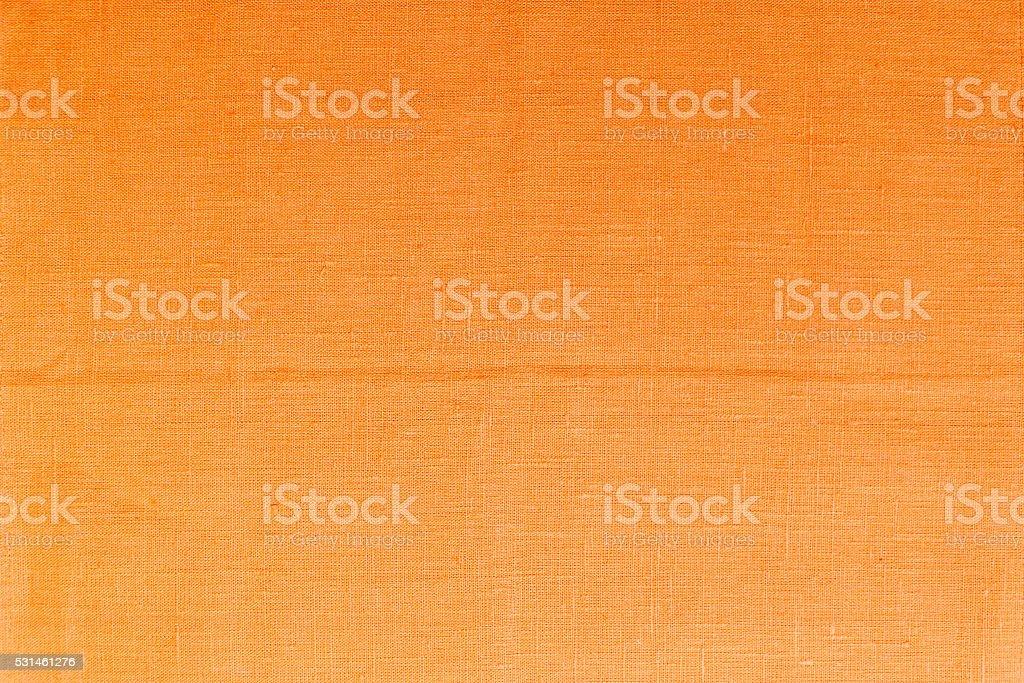 Orange linen tablecloth picnic texture. stock photo