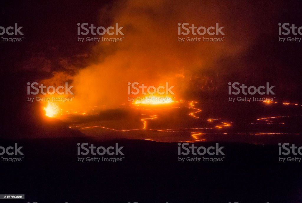 Orange Magma Errupting Inside Hawaii's Kilauea Volcano Crater stock photo