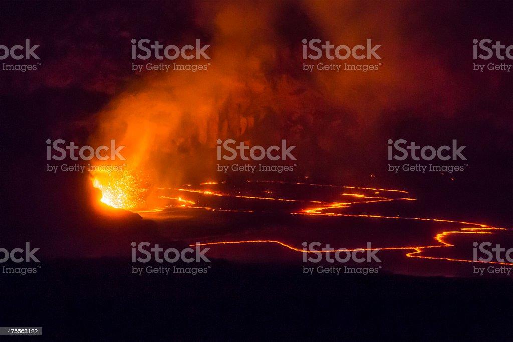 Orange Magma Errupting Inside Hawaii's Kilauea Volcano stock photo