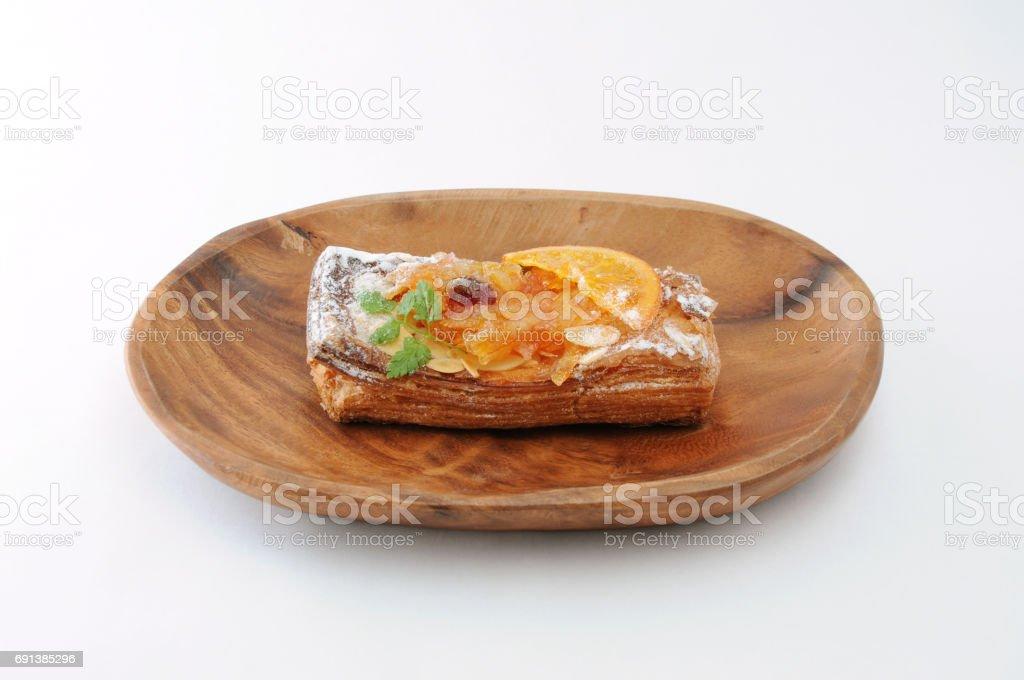 orange marmalade tart pie on a plate on white background stock photo