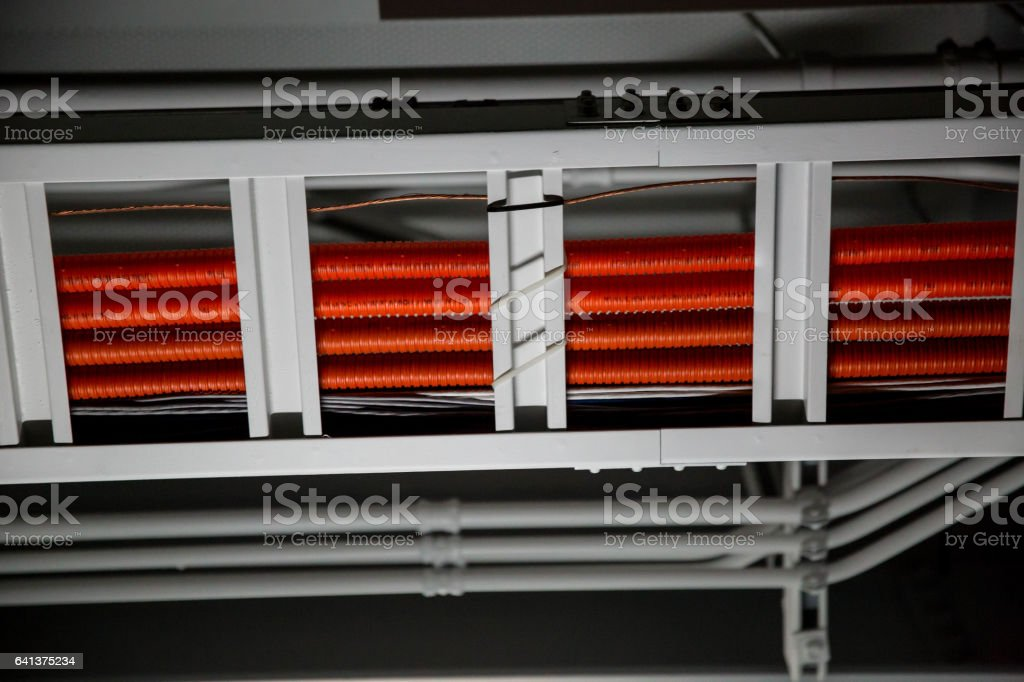 Orange Network Cables Running on Ceiling stock photo
