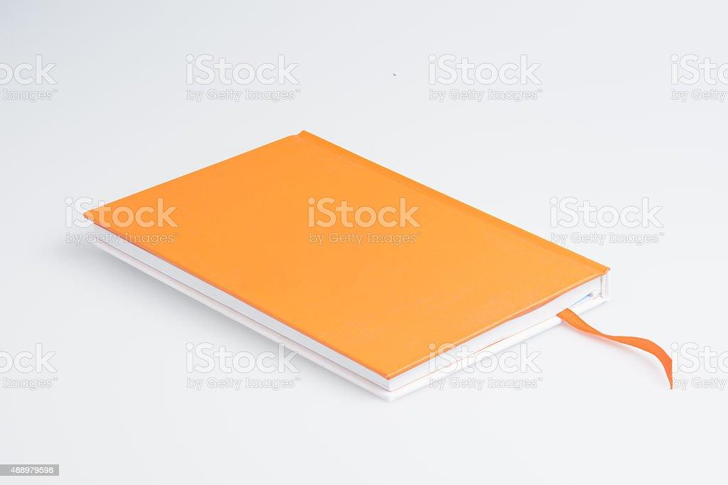 Orange note book stock photo