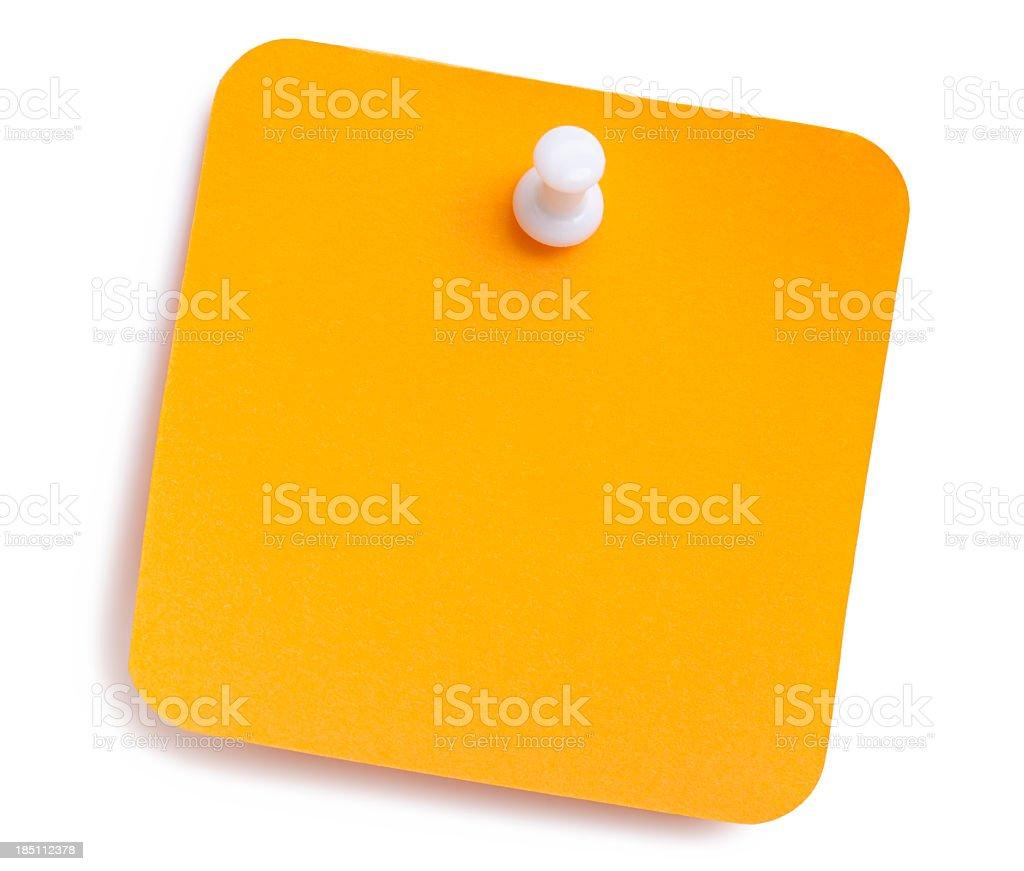 Orange note tacked to a white background stock photo