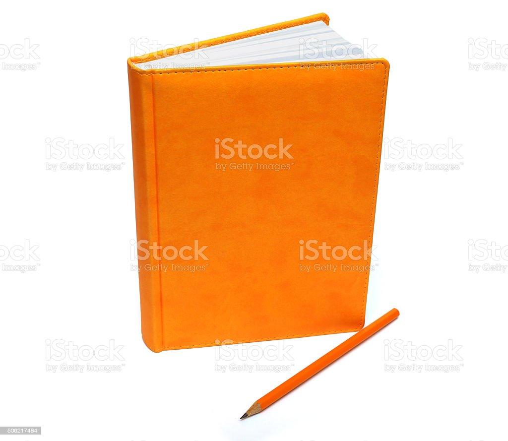 orange notebook and pencil stock photo