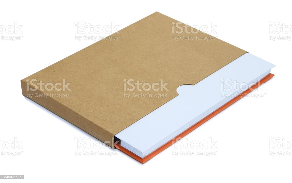 Orange notebook in brown paper case stock photo