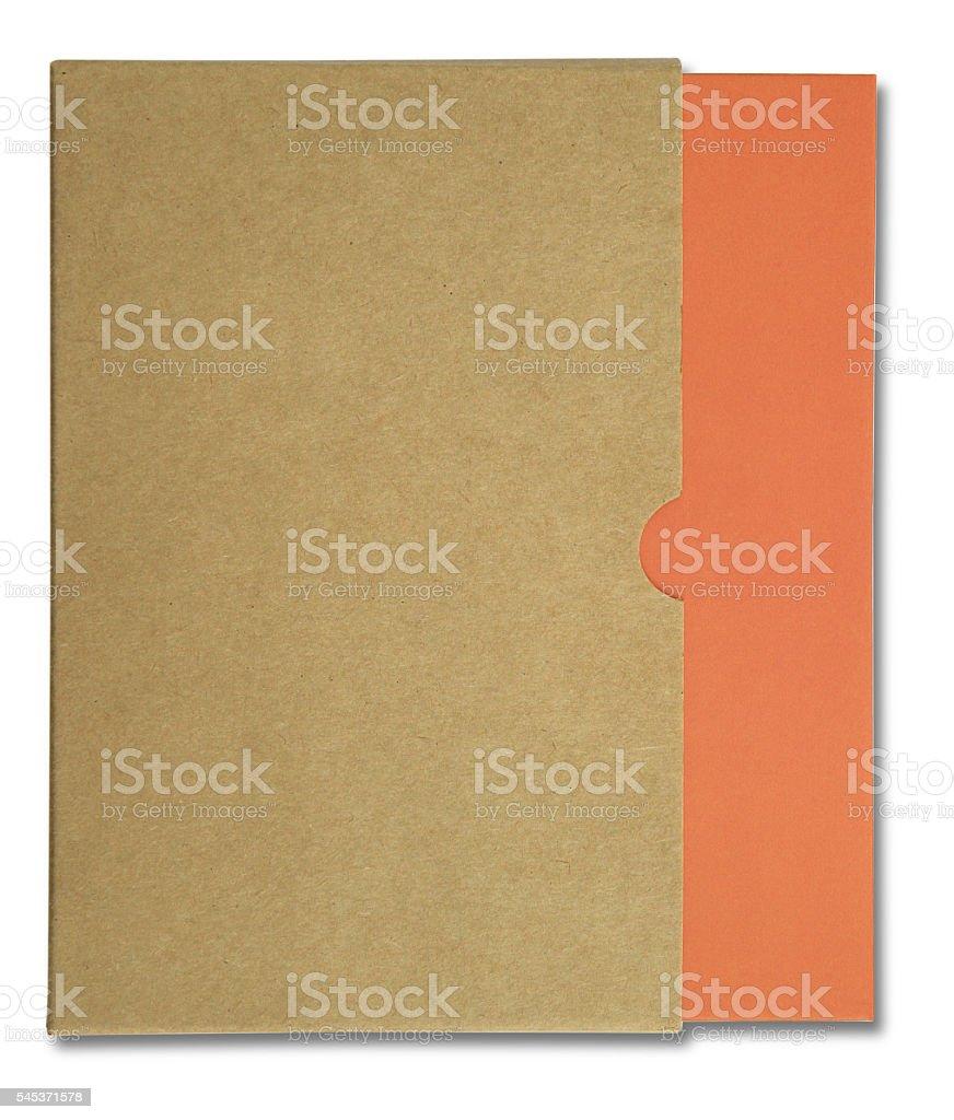 Orange notebook in brown paper case stock photo