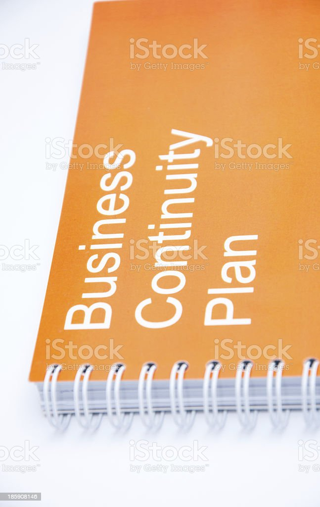 Orange notebook on a white backround stock photo