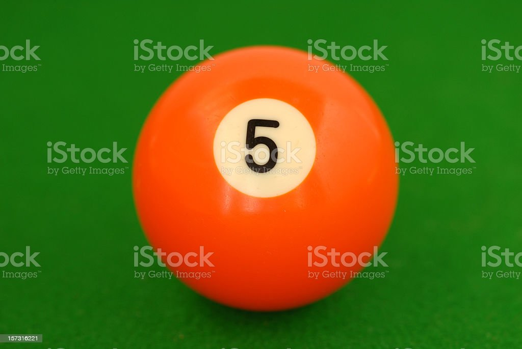 Orange number 5 billiard ball on green cloth royalty-free stock photo