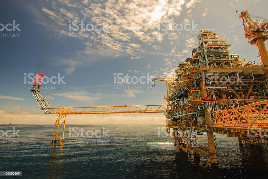 Orange oil and rig platform with sunny sky  royalty-free stock photo