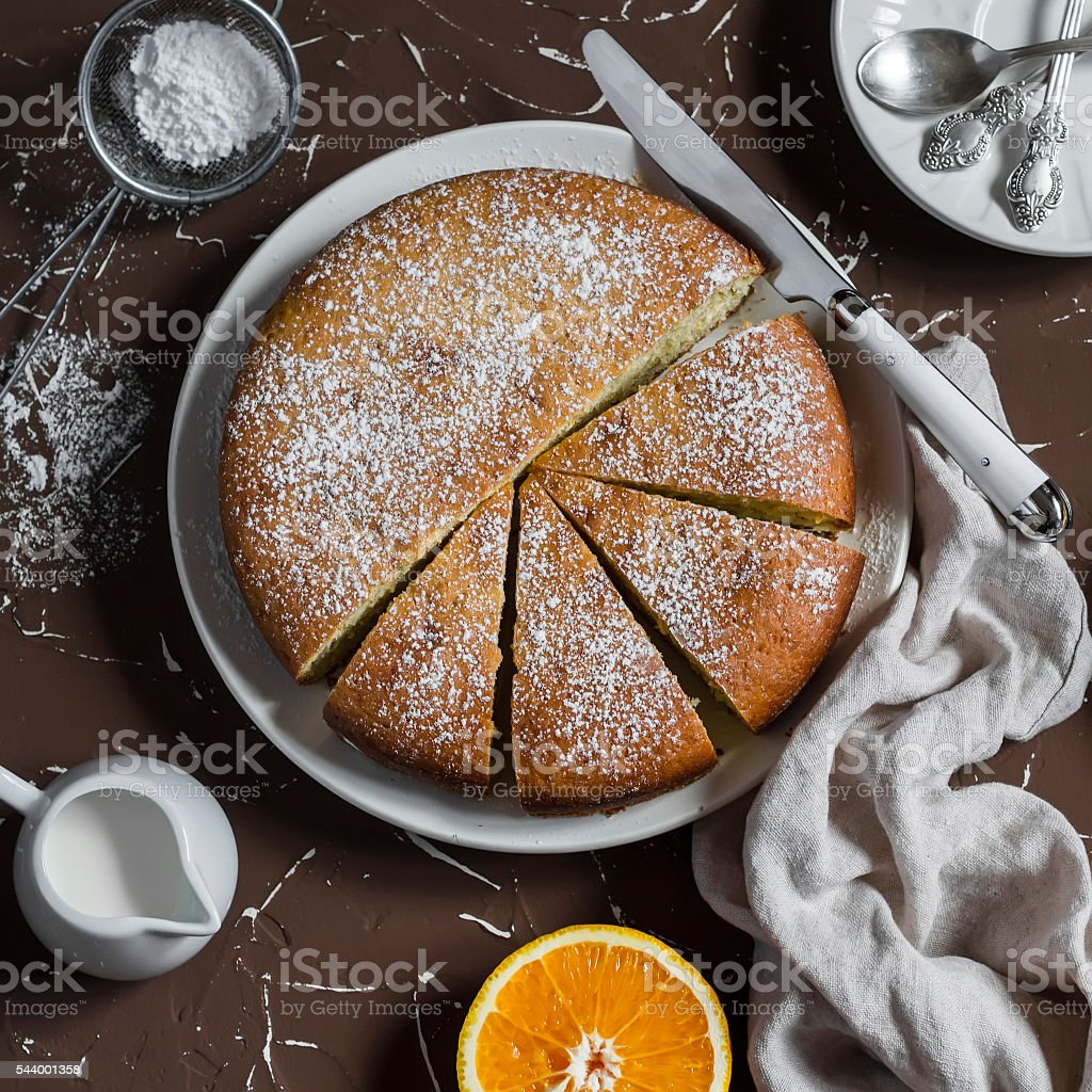 Orange olive oil cake on a brown stone background stock photo