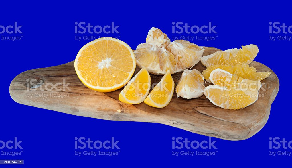 Orange on wooden plate isolated blue stock photo