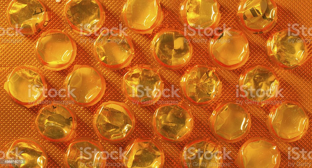 Orange package of pills tablets drug medicine as background royalty-free stock photo