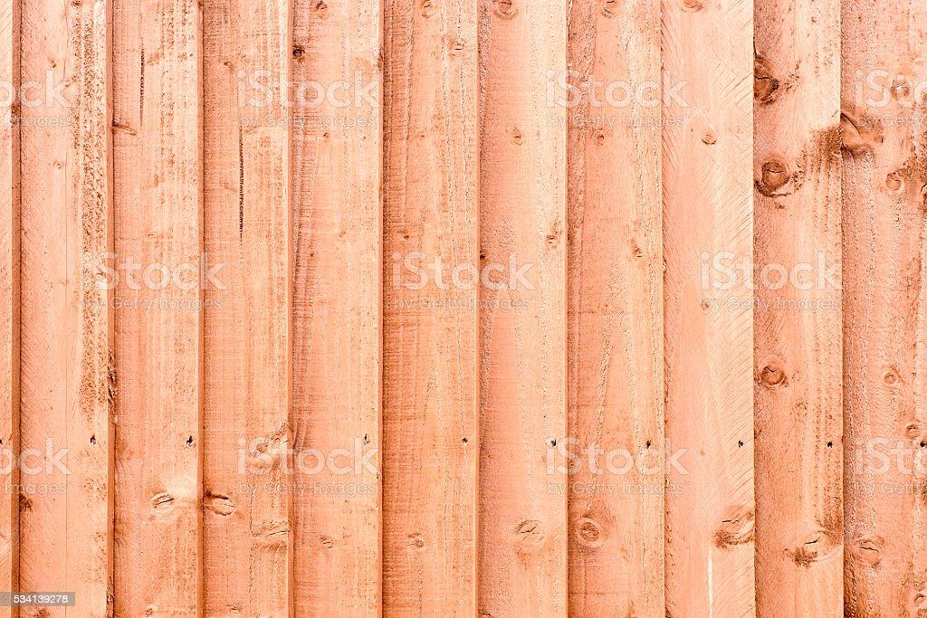 Orange Painted Wooden Fence Background stock photo