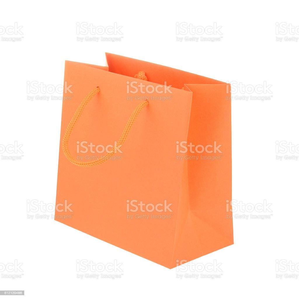 Orange paper shopping bag isolated stock photo