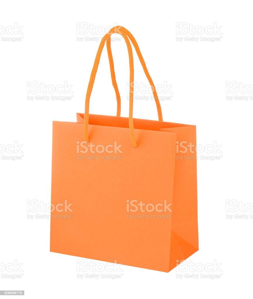 Orange paper shopping bag stock photo